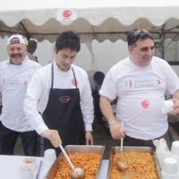 'Assistenza': Elio Orsara (right), owner and chef of the Tokyo restaurant Elio Locanda Italiana, and other volunteers offer free pasta to people at an evacuation center in Rikuzentakata, Iwate Prefecture, on May 8. | MS JAPAN SERVICE CO./KYODO PHOTO