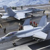 Ready for take-off: F/A-18 Super Hornet fighters, likely to be adopted as Japan's main nextgeneration fighters, prepare to take off from the USS George Washington in the Pacific near Minamidaito Island in Okinawa Prefecture on Dec. 9.