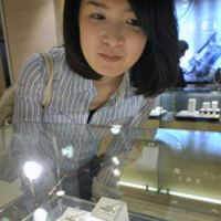Eyes on the prize: A woman looks at wedding rings at the Shinjuku Takashimaya department store in April. | KYODO