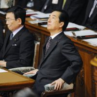 Heaven help me: Prime Minister Naoto Kan, who expressed his intention to resign Thursday, listens to a speech by Tadamori Oshima, vice president of the Liberal Democratic Party, before a vote on a no-confidence motion the same day at a Lower House plenary session. | KYODO PHOTO