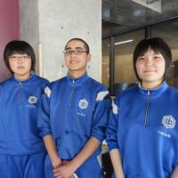 Standing tall: Kamaishi East Junior High School students Kana Sasaki (left), Fumiya Akasaka (center) and Aki Kawasaki pose for a picture in late May. | SETSUKO KAMIYA PHOTO