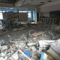 One of the school's classrooms is seen full of debris. | SETSUKO KAMIYA PHOTO