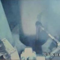 Where there's smoke: A video image from the Fukushima No. 1 power plant shows steam rising from an opening in the floor of the No. 1 reactor building Friday. | TEPCO / AP