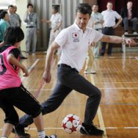Having a ball: Danish Crown Prince Frederik plays soccer with elementary school students in Higashimatsushima, Miyagi Prefecture, on Tuesday. | AP