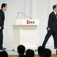 Rift widens: Former Democratic Party of Japan chief Ichiro Ozawa walks off the stage after Prime Minister Naoto Kan was re-elected party president in September 2010. | KYODO PHOTO