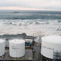 The deluge: Tsunami bear down on the Fukushima No. 1 nuclear plant on March 11. | KYODO