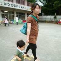 Homeward bound: A mother takes her child home from a day care center in Ebina, Kanagawa Prefecture, on June 10. | KYODO PHOTO