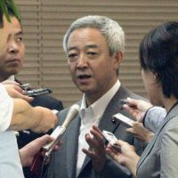 Sorry: Tohoku reconstruction minister Ryu Matsumoto faces reporters at the Prime Minister's Office on Monday. | KYODO PHOTO
