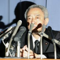 Quick exit: Departing reconstruction minister Ryu Matsumoto faces the media Tuesday morning in Tokyo. | KYODO