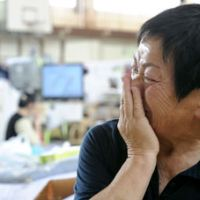 Hoping for better: Yoshie Otomo, a survivor of the March 11 quake and tsunami, cries as she talks about the resignation of postdisaster reconstruction minister Ryu Matsumoto. 'We don't need a minister like that. Governors, mayors, ward chiefs — everybody is hanging on here,' she said at an evacuation center in Sendai. | KYODO