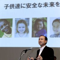 High energy: Softbank Corp. President Masayoshi Son speaks during a press conference in Osaka on May 26, announcing his intention to set up a subsidiary to build renewable energy power plants in Japan. | KYODO PHOTO