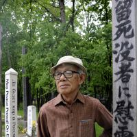 Fallen comrades: Takeshi Tanaka, a former postwar prisoner in Siberia, stands in a cemetery for Japanese soldiers in Khabarovsk, Russia, on May 31. | KYODO