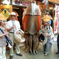 Squid stuff: Squid character Ikaaru Seijin enjoys the attention of tourists while being displayed outside a shop selling character goods in Hakodate, Hokkaido, recently. | KYODO PHOTO