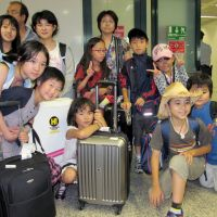 Roman holiday: Children affected by the March 11 quake and tsunami arrive at Fiumicino Airport in Rome on Wednesday to spend the summer with Italian host families. | KYODO PHOTOS