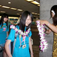 Hawaiian hospitality: Children from disaster-hit areas in the Tohoku region arrive at Honolulu on Wednesday.