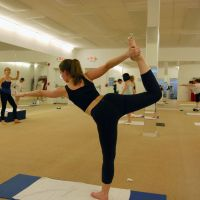 Life force: Megan Miller Yoo strikes a yoga pose as she and other students take part in a special class in New York to raise funds for Tohoku disaster victims. | KYODO PHOTO