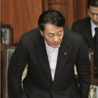 First step: Industry minister Banri Kaieda bows in appreciation after a bill to facilitate compensation to victims of the nuclear accident at the Fukushima No.1 power plant cleared the Upper House on Wednesday. | KYODO