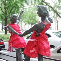 Art on art: A sculpture featuring two ballerinas dancing on a pedestal is seen along Midosuji street in downtown Osaka. The sculpture is one of several works that suddenly appeared clothed in red at the end of July in what was apparently a harmless prank. | KYODO PHOTO