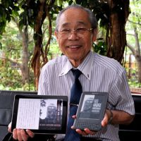 Spreading the digital word: Takuma Fukuyama displays the digital version of his book 'No More Hiroshima Nagasaki' on his iPad 2 and Kindle e-reader during an interview in late July with The Japan Times in Tokyo. | YOSHIAKI MIURA PHOTO