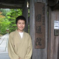 Welcome: Haruka Amano, a priest at Entsuin in Matsushima, Miyagi Prefecture, stands in front of the temple gate Aug. 4 | ALEX MARTIN