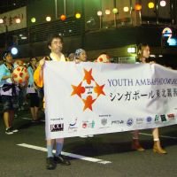 Festival atmosphere: Singaporean university students participate in the Yamagata Hanagasa Festival in the city of Yamagata during their tour of the Tohoku region on Aug. 5. | KYODO PHOTO