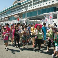 All ashore: Foreign tourists disembark from a passenger ship after arriving at Hakata port in Fukuoka Prefecture on Aug. 3. | KYODO PHOTO