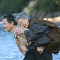 Award winner: Koji Yakusho portrays novelist Yasushi Inoue as he carries his mother, played by Kiki Kirin, in the film 'Waga Haha no Ki.' | KYODO PHOTO