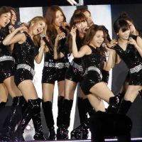 Taking Asia by storm: Members of Girls' Generation perform at the K-Pop All-Star concert in Niigata on Aug. 20. | AP PHOTO