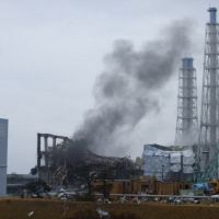 Not good: Gray smoke rises March 21 from unit 3 of the Fukushima No. 1 nuclear power plant. | TEPCO/AP