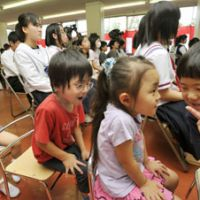 Can-go zone: Relocated kindergartners and students from schools in the town of Tomioka, located in the 20-km no-go zone around the Fukushima No. 1 plant, attend a joint opening ceremony Thursday for their new schools in Miharu, some 50 km to the west. | KYODO PHOTO