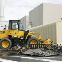 Dry run: A worker bulldozes debris during a disaster drill Thursday at the Hamaoka nuclear power plant in Shizuoka Prefecture. | KYODO PHOTO