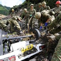 Car wreck: Ground Self-Defense Force personnel search Tuesday for missing people in a vehicle in Gojo, Nara Prefecture, that was swept away in a mudslide caused by Typhoon Talas. | KYODO
