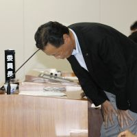 Undone by donations: Hobun Kihara, chief of the Saga Prefectural Assembly's nuclear safety panel, bows in apology during a committee session Aug. 23 at which he admitted to receiving political donations from six Kyushu Electric officials. | KYODO