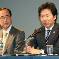 Money matters: Finance Minister Jun Azumi (right) and Bank of Japan Gov. Masaaki Shirakawa hold a news conference after a Group of Seven meeting in Marseille, France, on Friday. | KYODO PHOTO