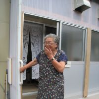 Staying put: Aiko Domeki, a 77-year-old resident of Yamada, Iwate Prefecture, stands in front of her temporary housing on Sept. 2. | TAKAHIRO FUKADA PHOTO