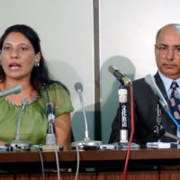 Guilty until proven innocent: Govinda Prasad Mainali's wife, Radha, speaks during a news conference Thursday in Tokyo, as his elder brother, Indra Prasad, looks on. | KYODO PHOTO