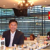 Market maven: Roger Tan, who helps run a pair of 'halal Japanese' restaurants in Singapore, takes a seat in one of them in July. | KYODO