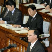 Bone to pick: Liberal Democratic Party President Sadakazu Tanigaki quizzes the government during Monday's Diet plenary session as Prime Minister Yoshihiko Noda behind him looks on. | KYODO PHOTO