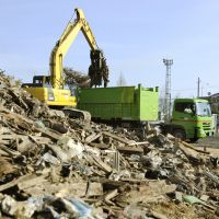 Mountain of trash: Debris is loaded onto a truck Wednesday morning in Miyako, Iwate Prefecture, for later transport by train to Tokyo, where it will be crushed at garbage-disposal facilities in Koto and Ota wards and incinerated at a facility in Koto Ward or used as landfill. | KYODO
