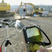 Watchful eye: A dosimeter shows radiation of 0.16 microsievert per hour at a debris collection site in Miyako, Iwate Prefecture, on Wednesday. The debris from the quake and tsunami is being dumped at a disposal site off Tokyo's Odaiba waterfront district. | KYODO PHOTO