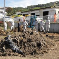 Unwanted earth: A heap of waste and soil collected during a decontamination program is piled up in the garden of a house in the Onami district in the city of Fukushima on Oct. 18, the day the city kicked off a cleanup drive that will last two years. | KAZUAKI NAGATA