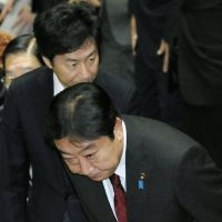 Budget passes: Prime Minister Yoshihiko Noda bows after the Lower House Budget Committee cleared the third extra budget Thursday. | KYODO