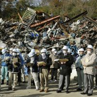 Inspection: Officials from 16 municipal governments across Japan inspect a temporary debris storage site in Miyako, Iwate Prefecture, on Friday. | KYODO