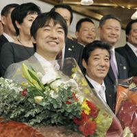 Double-header: Former Osaka Gov. Toru Hashimoto (left) and Ichiro Matsui celebrate their successful bids for Osaka mayor and Osaka governor in the rare double election Sunday. | KYODO PHOTO