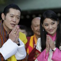 Keeping up appearances: Bhutan's King Jigme Khesar Namgyel Wangchuck and Queen Jetsun Pema appear before the media during a visit to Meiji Shrine in Tokyo on Nov. 17. | AP
