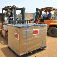 Ready to roll: Materials from Japan are extracted from cargo containers Saturday after reaching the Ground Self Defense Force's storage area in Juba, South Sudan, where the GSDF are participating in a U.N. peacekeeping mission. | KYODO
