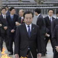 Into the fire: Prime Minister Yoshihiko Noda visits Peace Memorial Park in the Okinawan city of Itoman on Sunday. | KYODO