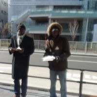 Paternal petition: African fathers separated from their children after divorcing Japanese women seek signatures from passersby in front of Futakotamagawa Station in Setagaya Ward, Tokyo, on Jan. 29. to urge the government to adopt a joint custody system. | KYODO