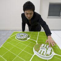 In the sky: Keiichiro Sako, chief architect at Sako Architects, explains his Tohoku Sky Village concept at the company's office in Tokyo on Jan. 30. | ROB GILHOOLY