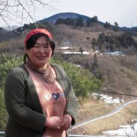 People of the soil: Mayumi Sugeno, an organic farmer in Nihonmatsu, Fukushima Prefecture, stands outside her home on Feb. 20. | MIZUHO AOKI
